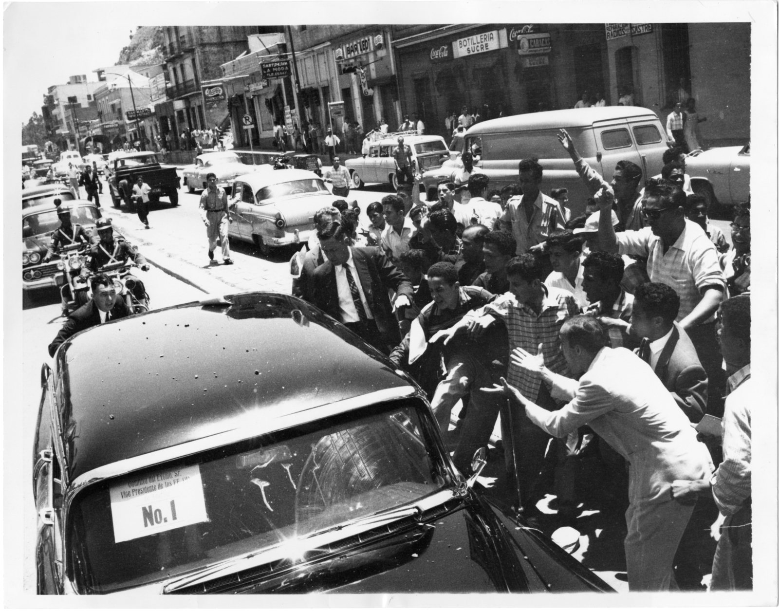 Vice President Richard Nixon's motorcade drives through Caracas, Venezuela and is attacked by demonstrators