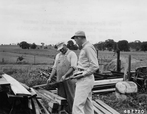 Photograph of Farm Forester and Sawmill Owner Discussing Lumber Grades and Markets for Low Grade Material