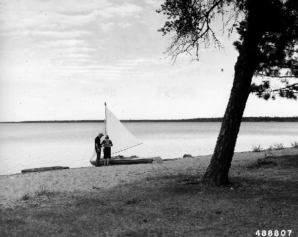 Photograph of a Couple from Ohio Ready to Sail Their Kayak on Pike Bay