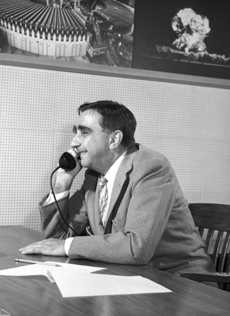 Dr. Edward Teller at desk talking on telephone, taken October 1958. Morgue 1958-12 (P-4) [Photographer: Donald Cooksey]