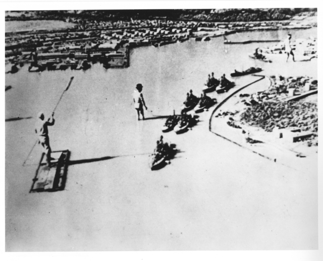 Photograph of Japanese Wasing in Pool with Mockup of Ford Island and Battleship Row