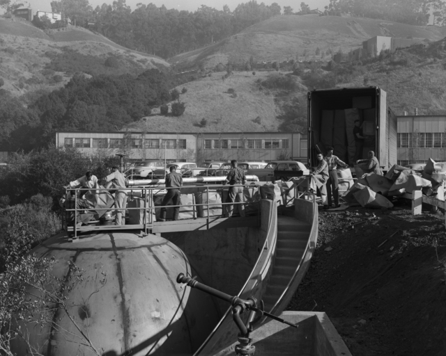 Cans are loaded into the sphere for the 72-inch bubble chamber. Left to right: Ross Lamb (Mechanical Equipment), Frank Barrera (mechanical engineering), Mel West (mechanical equipment), Herb Johnson (mechanical shops), Joe Holdener (mechanical shops), Lou Sylvia (mechanical equipment), Robbie Smits (physics research), and Bob Stagner (plant services), taken January 1959. Morgue 1959-29 (P-1) [Photographer: Donald Cooksey]