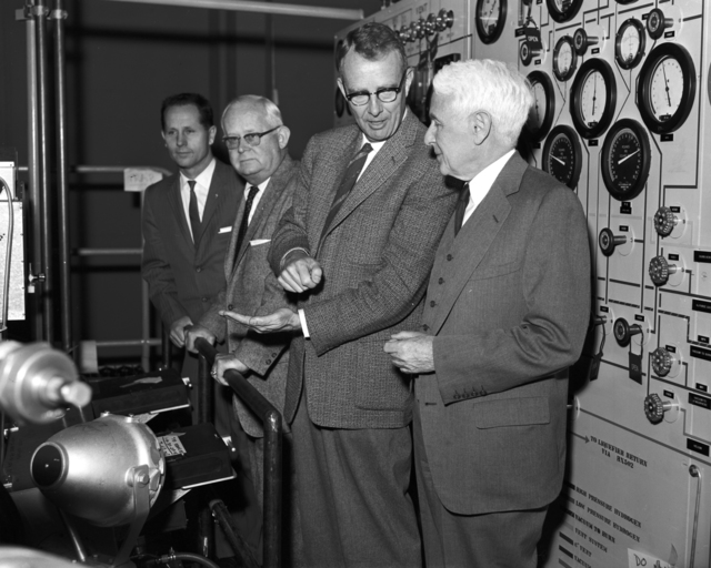 Luis Alverez (second from right) with unidentified individuals at Board of Regents meeting tour, taken March 12, 1959. Morgue 1959-17 (P-12) [Photographer: Donald Cooksey]
