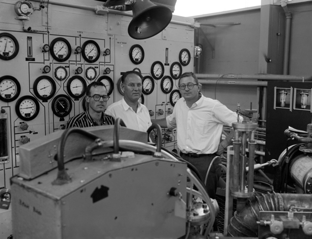 72-inch hydrogen bubble chamber (biggest in the world) was christened at Lawrence Berkeley Laboratory on June 22, 1959. Left to right on the top-platform control panel of the chamber: Ken Langley (operating crew chief), Bob Watt (physicist), and Dick Blumberg (mechanical engineer). Magnet 1959-46 (P-2) [Photographer: Donald Cooksey]