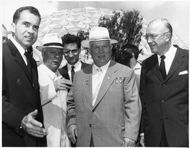 Richard Nixon and Nikita Khrushchev chat before touring the American Exhibition at Sokolniki Park in Moscow. Also present are Soviet Premier Klimenti Voroshilov (2nd from Left) and Dr. Milton Eisenhower (Far Right)