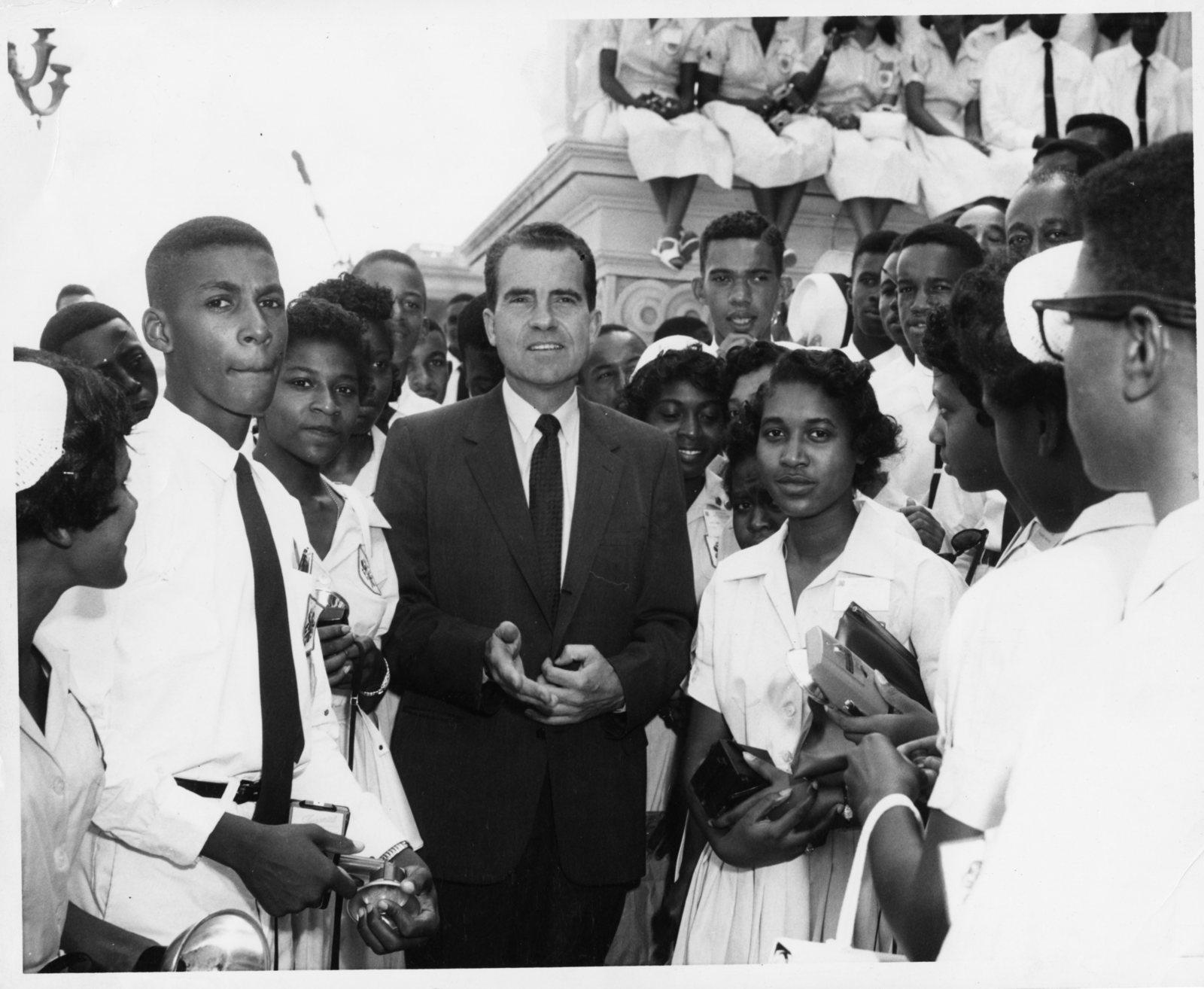 Richard Nixon stands amongst a group of 4-H members visiting Washington, D.C