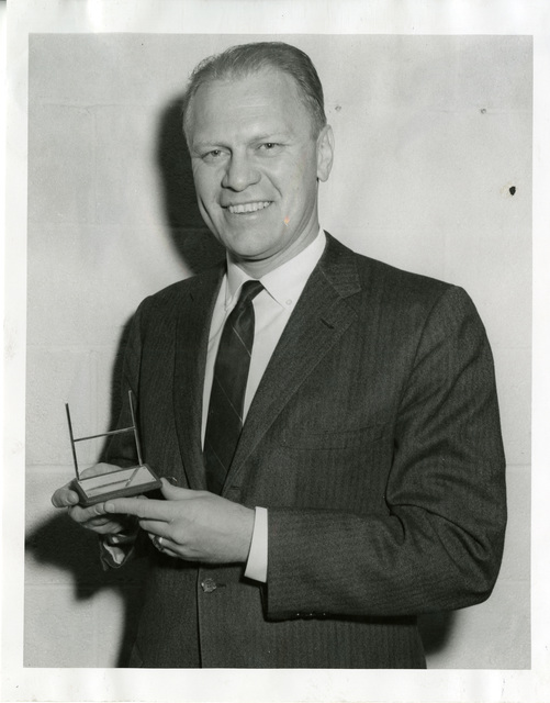 Photograph of Representative Gerald R. Ford, Jr., Posing with His Sports Illustrated Silver Anniversary Award