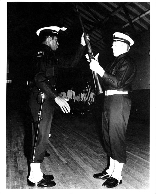 An African American Naval Cadet Instructing a Fellow Naval Cadet