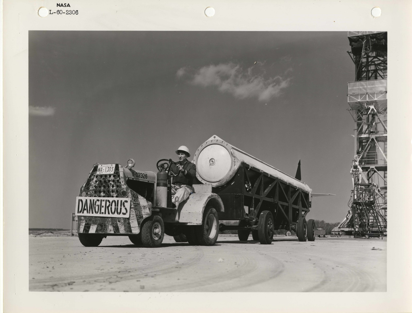 Photograph of a Scientist Driving a Rocket Part to a Launch Pad at the Langley Research Center in Hampton, Virginia