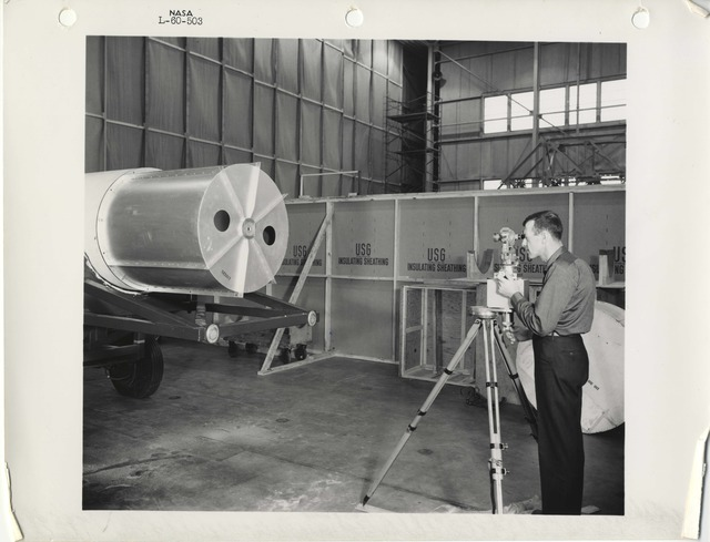 Photograph of a Scientist taking a Photograph of a Rocket Part at the Langley Research Center in Hampton, Virginia