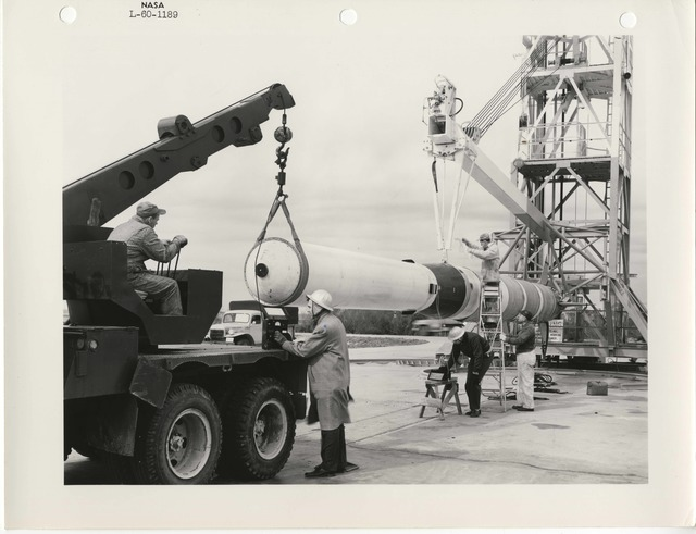 Photograph of Scientists and Engineers Using a Crane and Other Motor Vehicles in Preparation to Raise a Rocket for Launch at the Langley Research Center in Hampton, Virginia