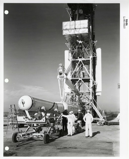 Photograph of Scientists preparing to Lift a Rocket onto the Launch Structure to be Prepared for Launch at the Wallops Island Launch Area in Virginia