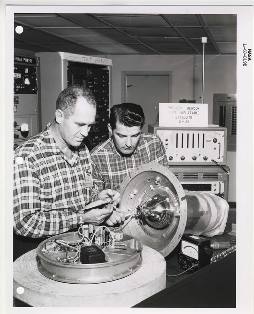 Photograph of Two Scientists Examining a Rocket Part Related to Project Beacon, at the Langley Research Center in Hampton, Virginia