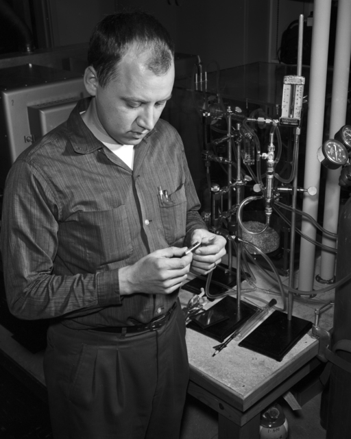 A solid-state counter is displayed be Berkeley chemist Bill Hansen, who has spent the past year perfecting this device for counting atomic particles. Taken, March 1960. Morgue 1960-44 (P-1) [Photographer: Donald Cooksey]