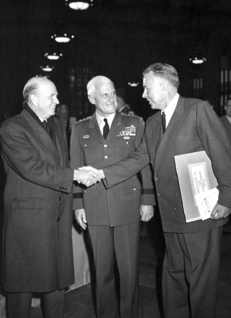 "Prof. Victor Spitsyn, Director of Instutute of Physical Science shaking hands with Ernest Orlando Lawrence 10/20/1960. Ernest Orlando Lawrence recieving the first Sylvauns Thayer Award in 1958, an award that is given each year by the United States Military Academy at West Point. The Thayer Award, established in honor of Col. Sylvanus Thayer, 'Father of the Military Academy,' is presented to an outstanding citizen whose service and accomplishments in the national interest exemplify the Military Academy motto, ""Duty, Honor, Country."" [Photographer: Unknown]"