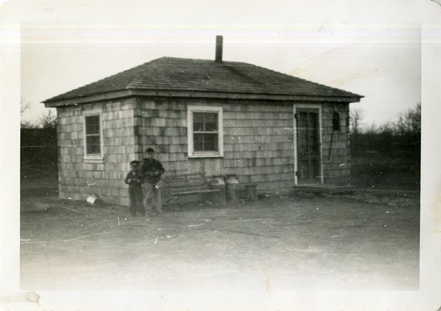 After Reconstruction of Ed Stands and Looks Back's House
