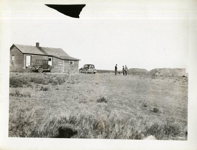 Buildings and Feed on Fred McIlroy's Farm; RR Client, P-H District, Unpainted Farmhouse