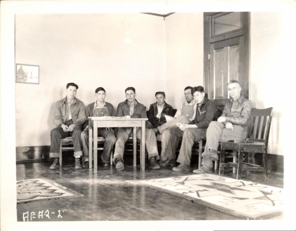 Group of Men Seated Around Table