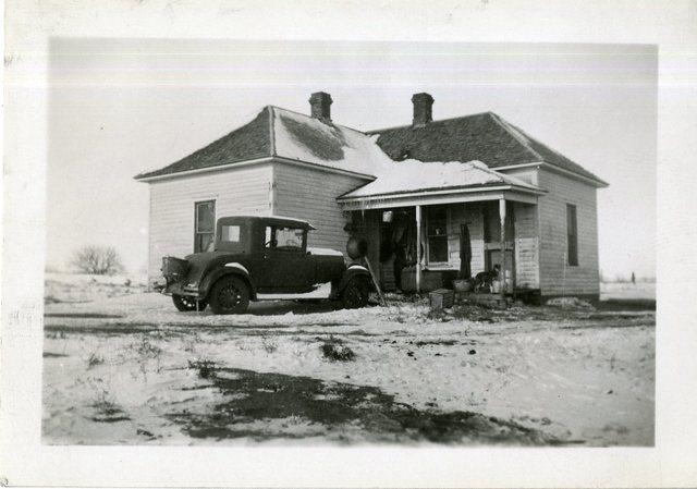 Noel Lunderman House (Small Unpainted Frame House)