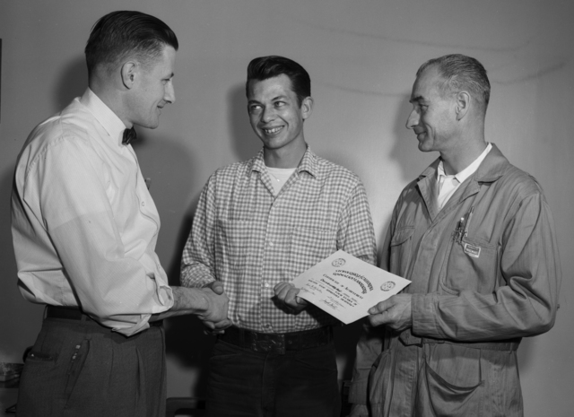 Mechanical Shops journeyman James Felter awarded Certificate of Achievement from foremen Carson Haines and Gerald Dishong for completing his apprenticeship, taken March 1961. Morgue 1961-49 (P-1) [Photographer: Donald Cooksey]