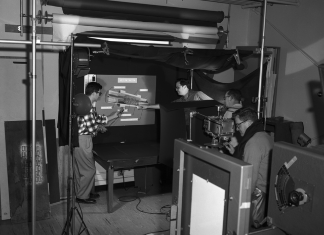 Personnel in the Graphic Arts Lab (Photolab) setting up photoshoot, Building 10, taken May 16, 1961. Morgue 1961-7 (P-5) [Photographer: Donald Cooksey]
