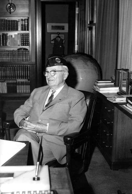 Photograph of Harry S. Truman in his Office at the Truman Library