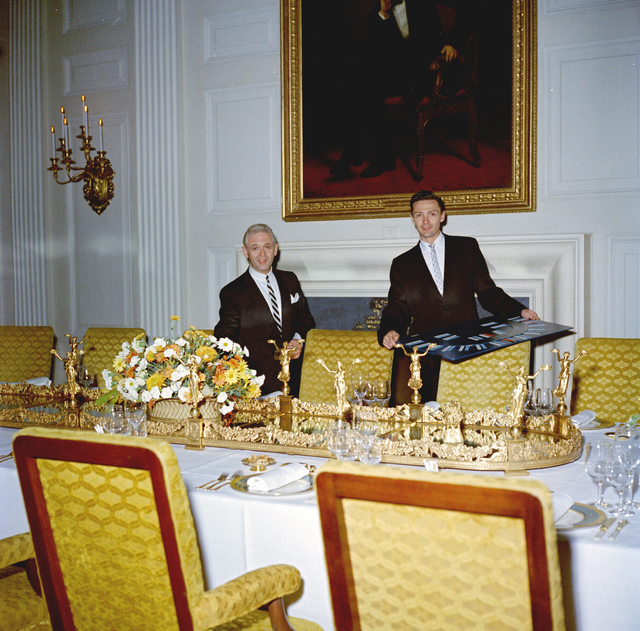 """Chief of the White House Social Entertainments Office Sanford """"Sandy"""" Fox and Assistant Chief of the White House Social Entertainments Office Russell Armentrout, Setting the Table for a Dinner in Honor of Former President Harry S. Truman"""