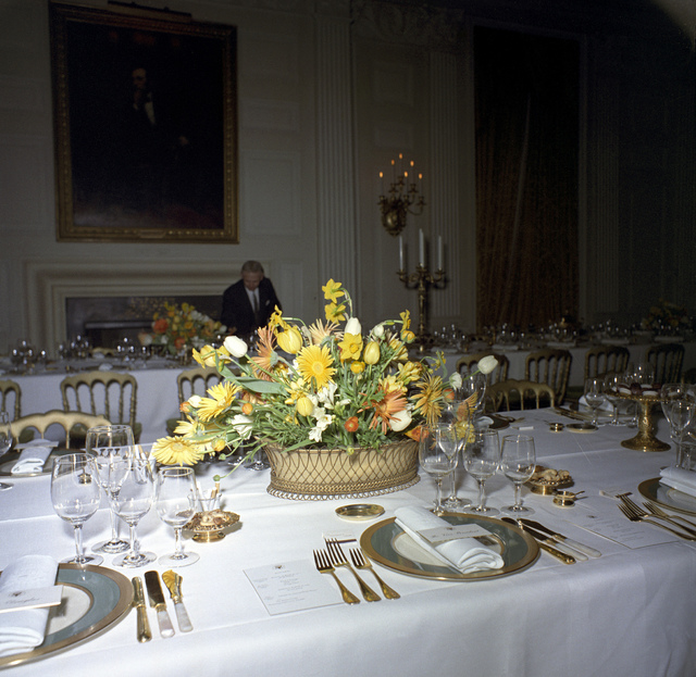 Floral Centerpiece and Place Settings for a Dinner in Honor of Vice President Lyndon B. Johnson, Speaker of the House of Representatives John W. McCormack, and Supreme Court Chief Justice Earl Warren