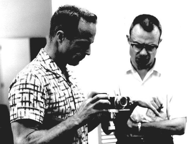 Photograph of Astronaut M. Scott Carpenter Discussing the Operation of a Camera