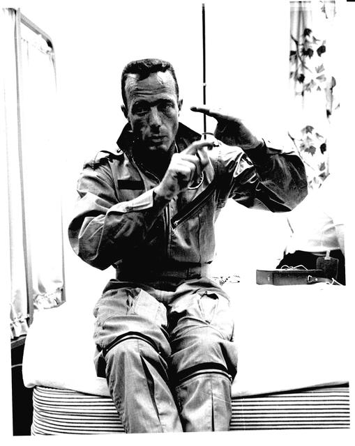 Photograph of Astronaut M. Scott Carpenter Using His Hands to Describe Phases of His Aurora 7 Flight