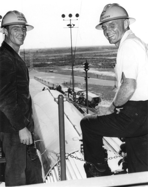 Photograph of Astronauts M. Scott Carpenter and John H. Glenn, Jr. Overlooking the Erection of the Launch Vehicle