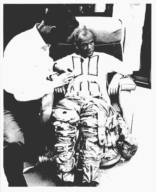 Photograph of Astronaut John H. Glenn, Jr. being Suited-Up