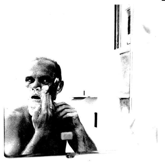 Photograph of Astronaut John H. Glenn, Jr. Performing His Early Morning Shave