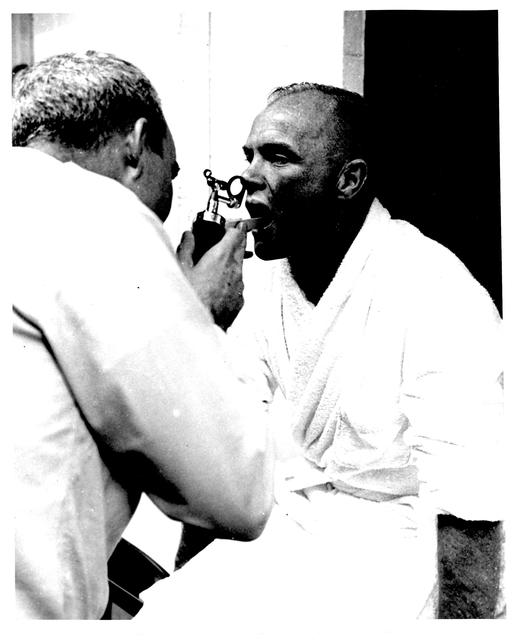Photograph of Astronaut John H. Glenn, Jr. Undergoing Last Minute Medical Checks