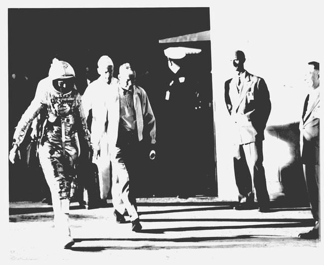 Photograph of Astronaut John H. Glenn, Jr. Walking to Capsule