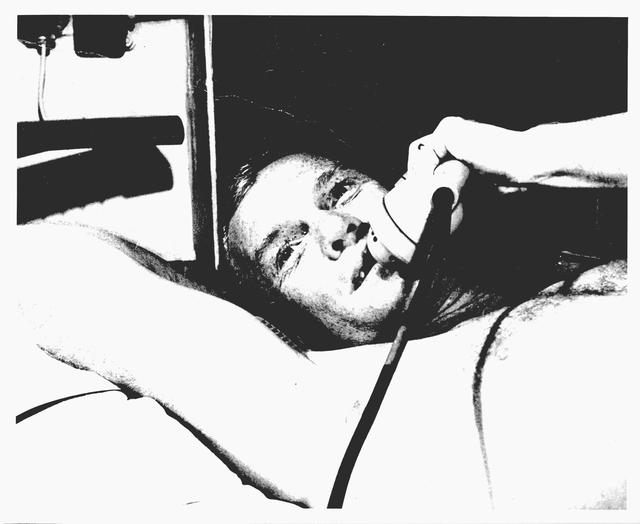 Photograph of Astronaut John H. Glenn, Jr. Talking on the Telephone after Friendship 7 Flight