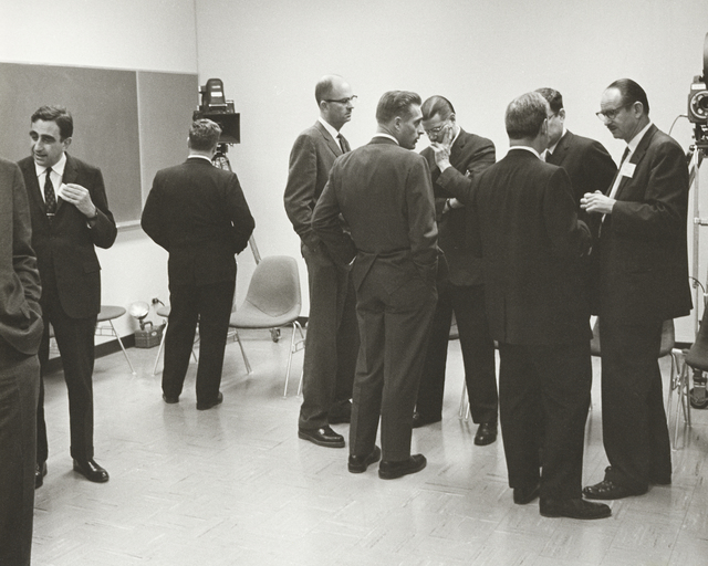 President John F. Kennedy 's visit to Lawrence Radiation Laboratory. Associate Director Edward Teller (left) and Edwin McMillan (right) among a group in briefing room, taken March 23, 1962. Principal Investigator/Project: Analog Conversion Project