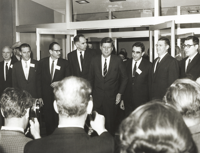 President John F. Kennedy 's visit to Lawrence Radiation Laboratory. From left to right: Norris Bradbury (LASL Director), John Foster (LRL Livermore Director), Edwin McMillan (LRL Director), Glenn Seaborg (AEC Chairman), President Kennedy, Edward Teller (LRL Associate Director), Robert McNamara (Defense Secretary), and Harold Brown (Director of Defense Research and Engineering), taken March 23, 1962. Principal Investigator/Project: Analog Conversion Project