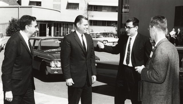 President John F. Kennedy 's visit to Lawrence Radiation Laboratory. From left: Edward Teller, Associate Director; Robert McNamara, Defense Secretary; and Harold Brown, Director of Defense Research and Engineering in discussion outside Building 70A, taken March 23, 1962. Principal Investigator/Project: Analog Conversion Project