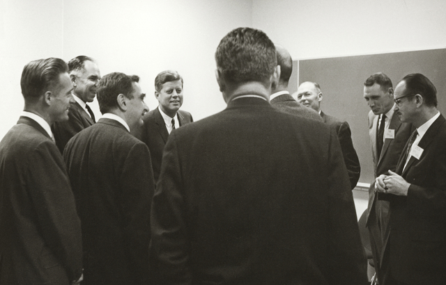 President John F. Kennedy 's visit to Lawrence Radiation Laboratory. President Kennedy talking with a group in briefing room, including Glenn Seaborg, Edwin McMillan, and Edward Teller (LRL Associate Director), taken March 23, 1962. Principal Investigator/Project: Analog Conversion Project