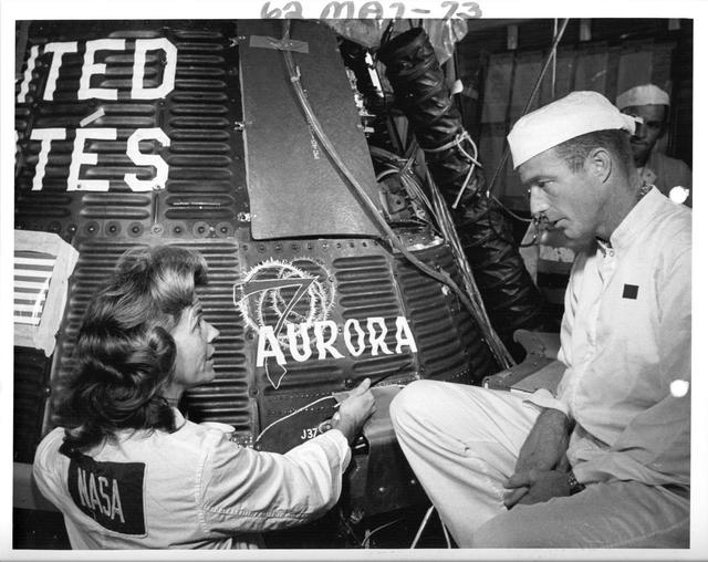 Photograph of Flight Name being Painted onto Spacecraft Aurora 7