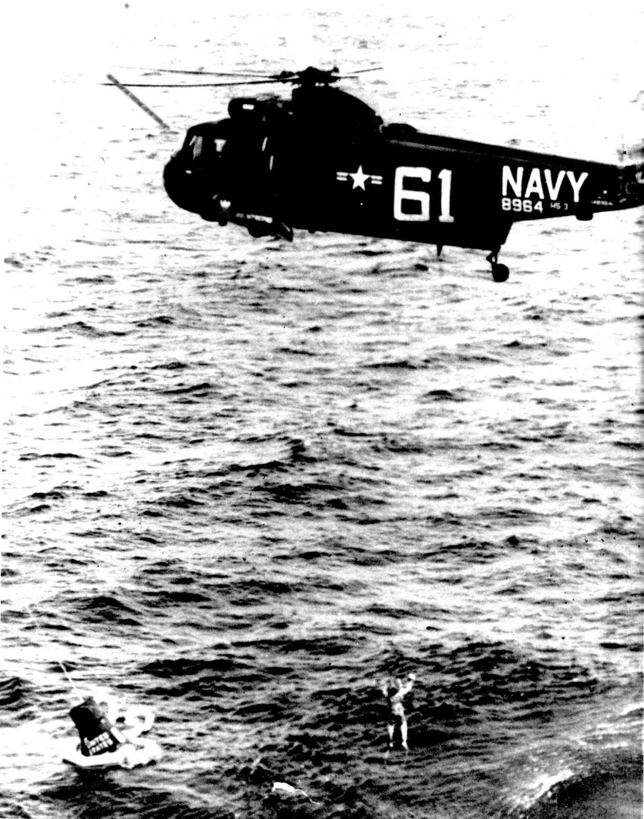 Photograph of Astronaut M. Scott Carpenter Being Recovered by a Navy Helicopter after the Aurora 7 Flight