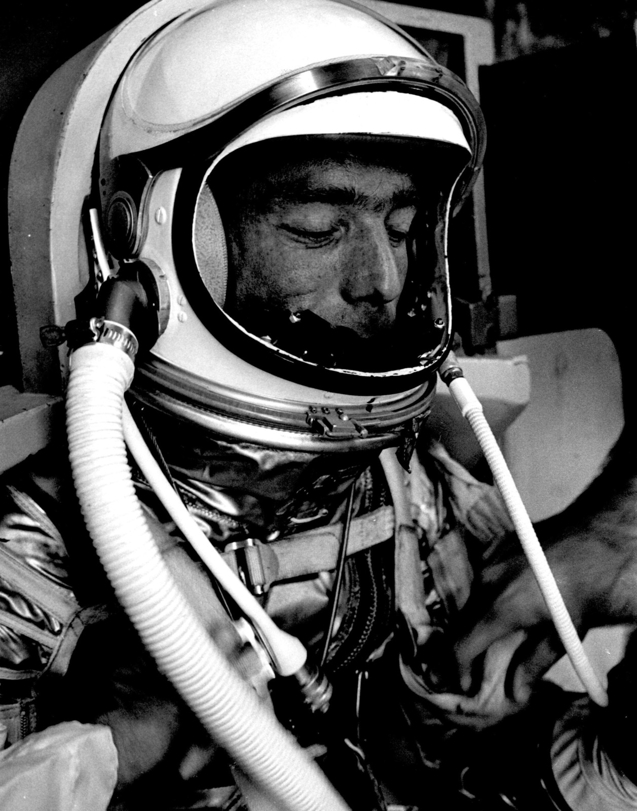 Photograph of Astronaut Malcolm Scott Carpenter Adjusting his Straps Prior to Aurora 7 Launch