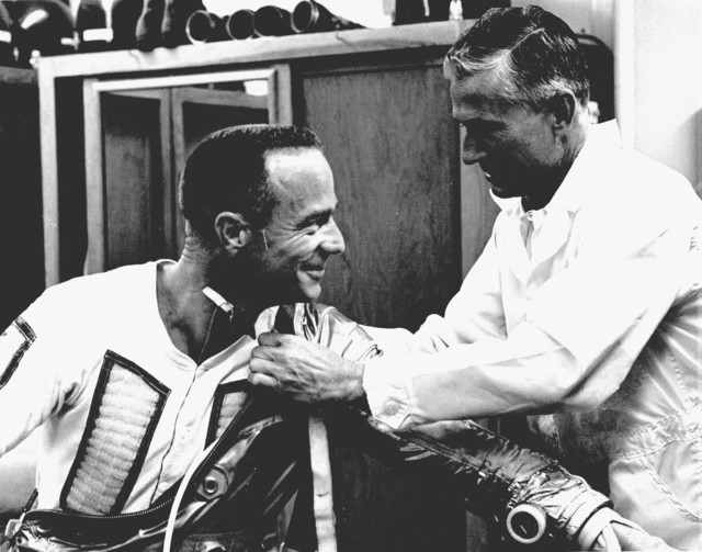Photograph of Astronaut Malcolm Scott Carpenter Putting on His Space Suit Prior to Aurora 7 Launch