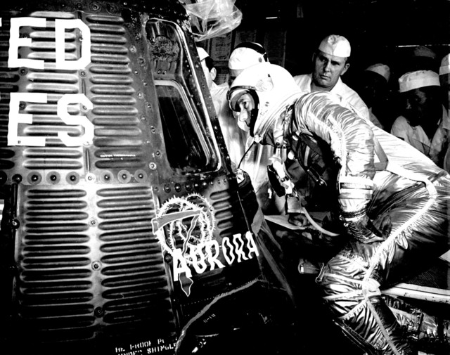 Photograph of Astronaut Scott Carpenter Looking inside his Aurora 7 Spacecraft prior to Launch