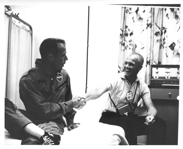 Photograph of Astronauts M. Scott Carpenter and John H. Glenn, Jr. Shaking Hands after Carpenter's Aurora 7 Flight