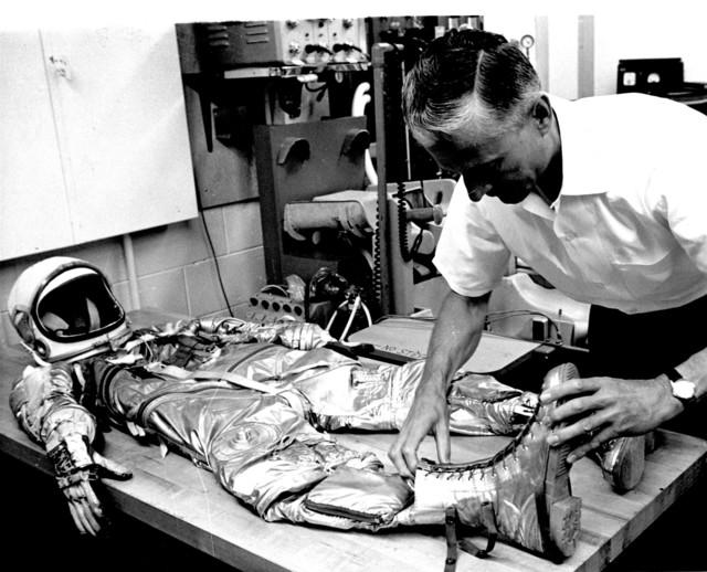 Photograph of the Suit Technician Checking Astronaut M. Scott Carpenter's Spacesuit Prior to Aurora 7 Launch