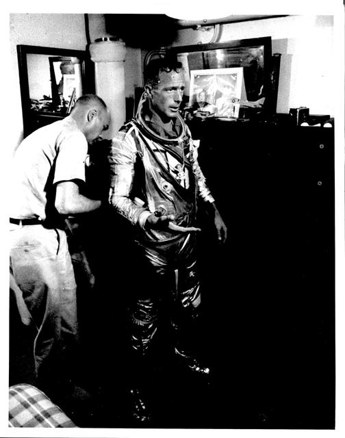 Photograph of Astronaut M. Scott Carpenter being Removed From His Flight Suit