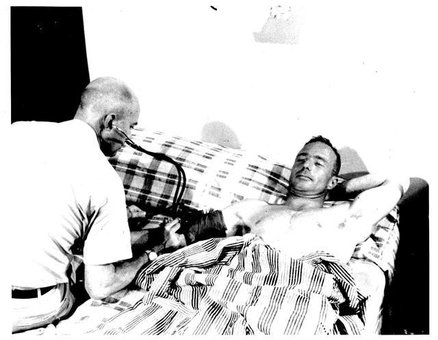 Photograph of Astronaut M. Scott Carpenter Having His Blood Pressure Checked after His Aurora 7 Flight