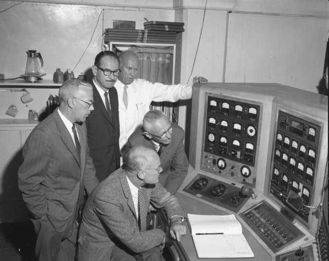 """Shutdown of  60-inch cyclotron at Crocker Lab. Clockwise from left: Unidentified individual, Ed McMillan, John Lawrence, Donald Cooksey, and Bob Thornton. Photo taken 6/22/1962. 60""""-617. Principal Investigator/Project: Crocker Lab/60-inch"""